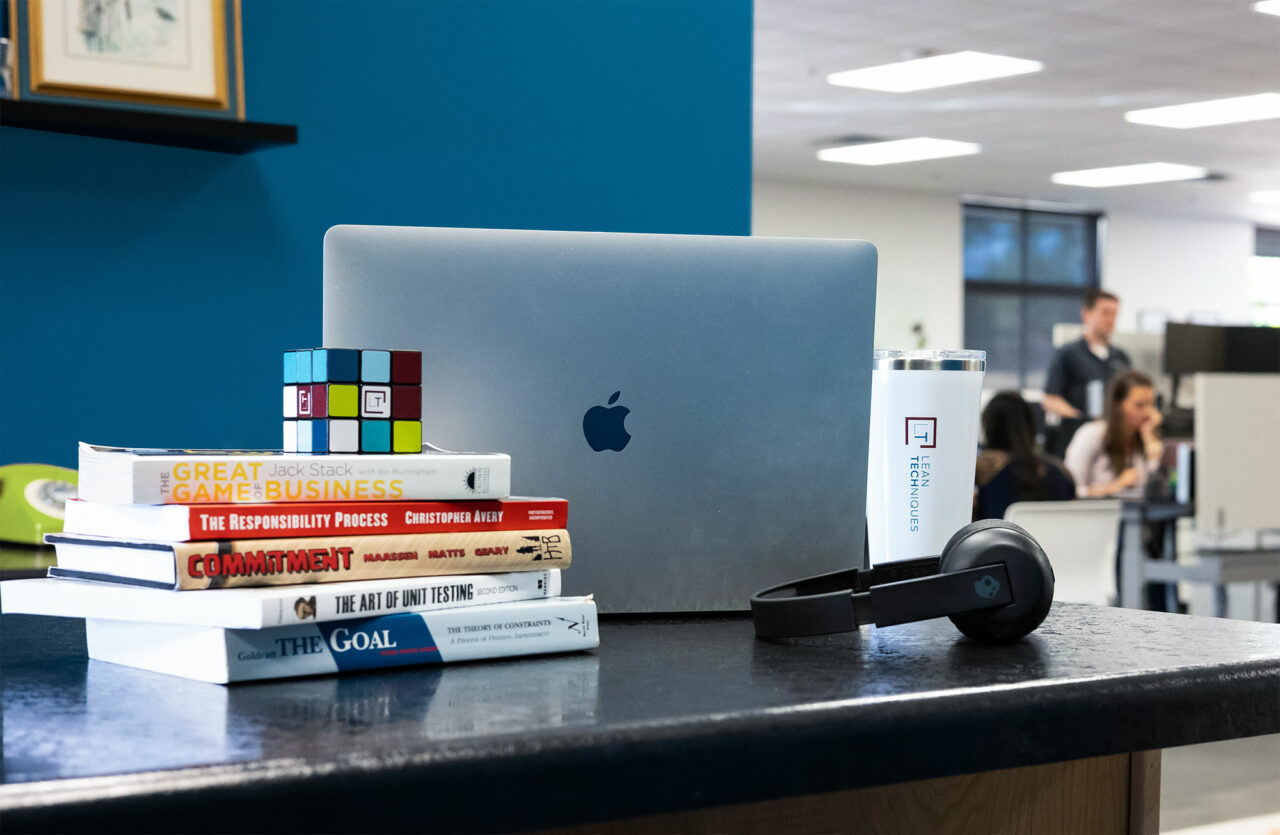 Laptop and books in the Lean TECHniques office.
